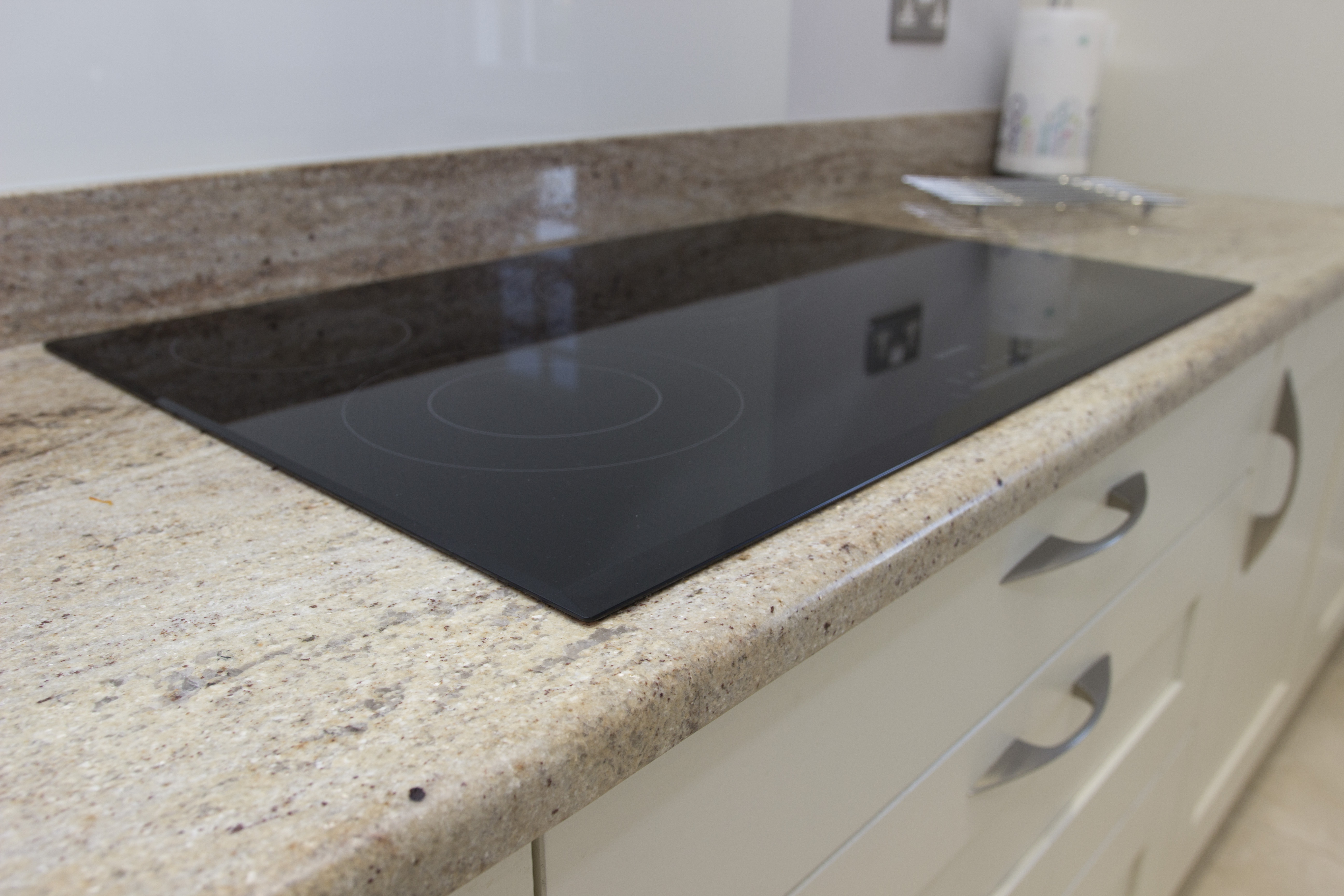 Sandstorm Granite - Kitchen by System Six Kitchens